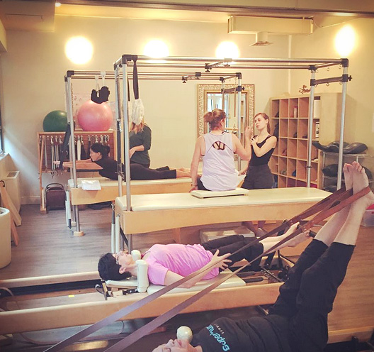 Clients doing their custom designed workouts in a group format at Boditree Pilates Vancover