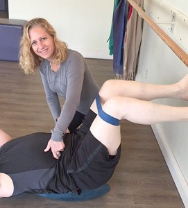 Risa of Boditree Pilates Vancouver at work with a client