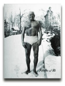 Joseph Pilates at 82 stands in the snow
